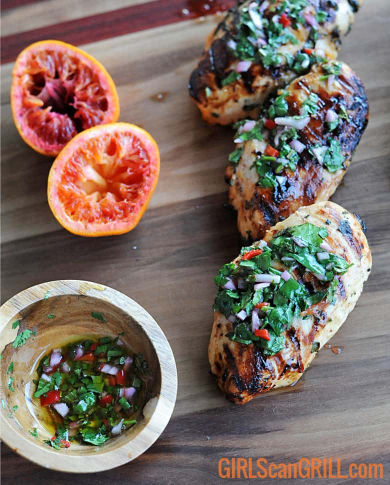 grilled chicken breast topped with fresh green chimichurri
