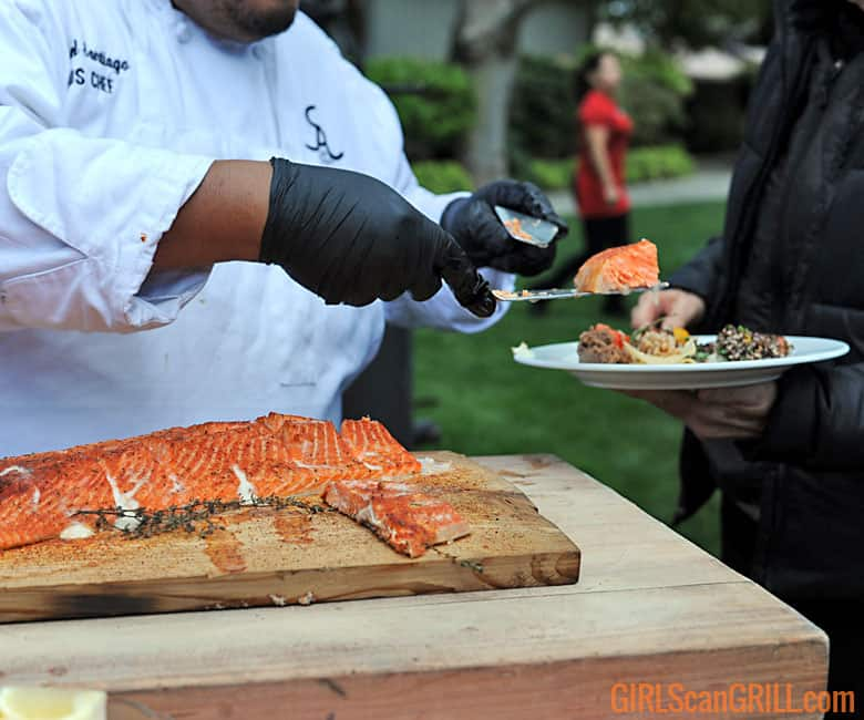 chef serving a slice of smoked trout