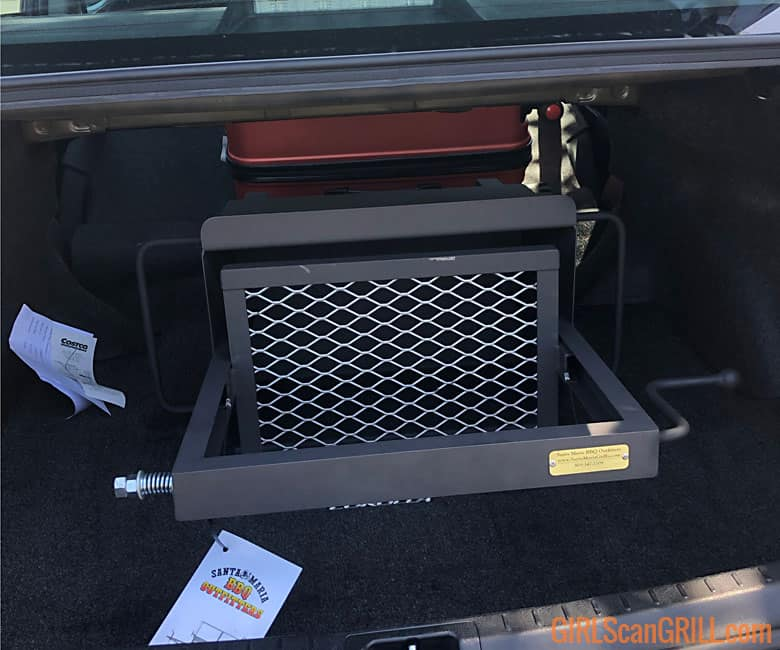 small santa maria grill on side in trunk of car