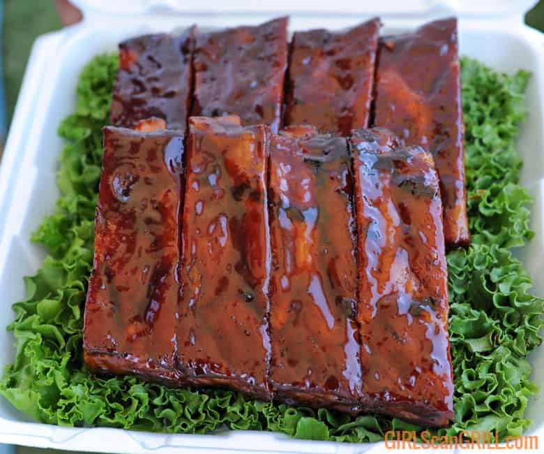 8 bbq ribs in a box on greens