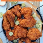 platter of fried nashville hot chicken with pickles