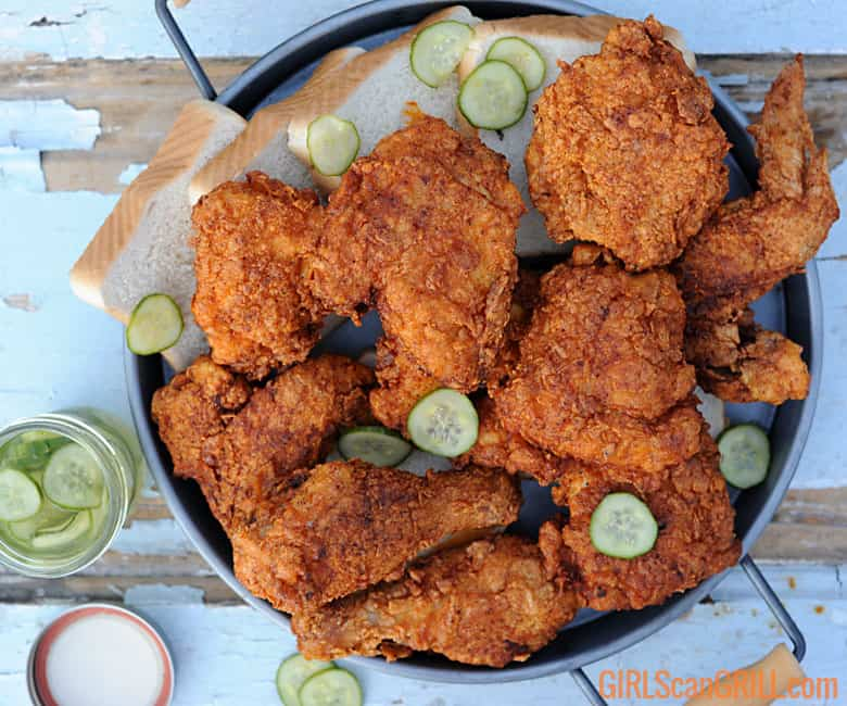 platter of fried nashville hot chicken with pickles
