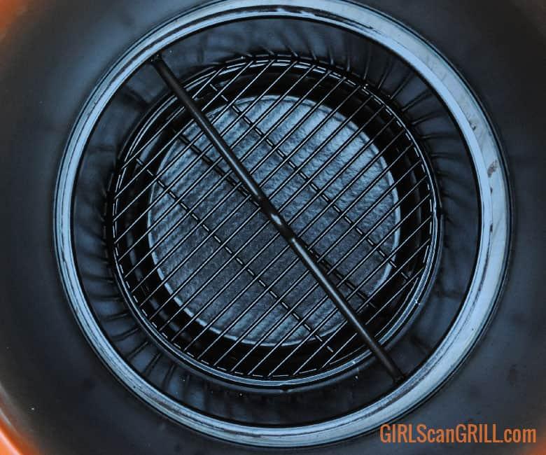 empty black charcoal basket in orange Oklahoma Joe's Bronco Pro Drum Smoker