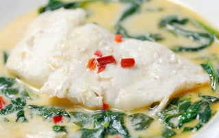 cod in coconut milk broth with spinach and fresno peppers