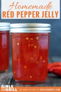 two jars full of bright red pepper jelly