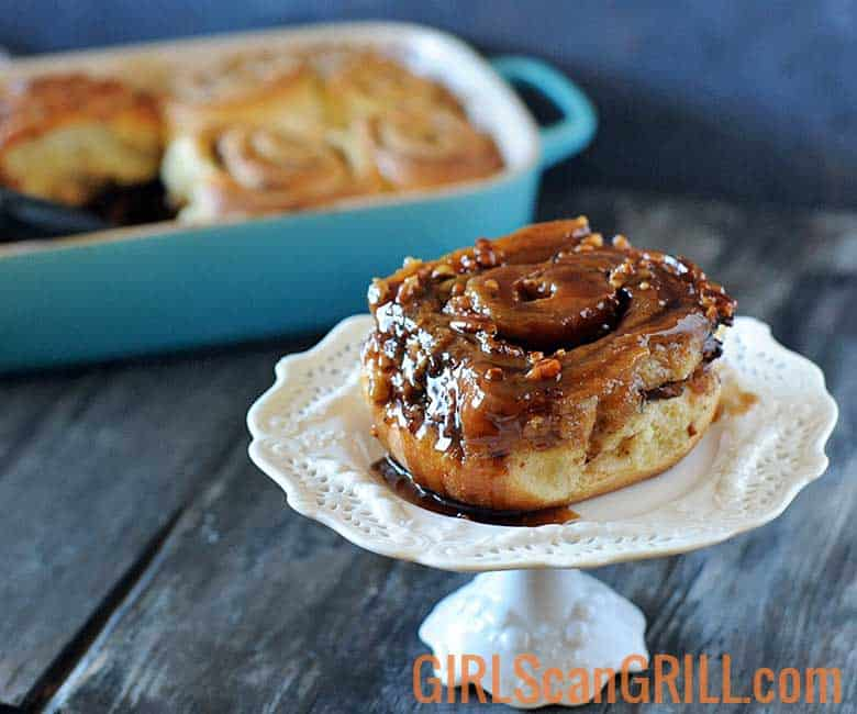 cinnamon roll on a white elevated plate