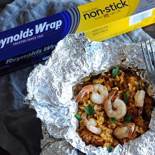 foil packet with cooked seafood paella