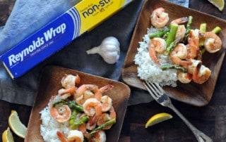 Lemon Garlic Butter Grilled Shrimp and Asparagus with box of Reynolds Wrap® Non-Stick Aluminum Foil