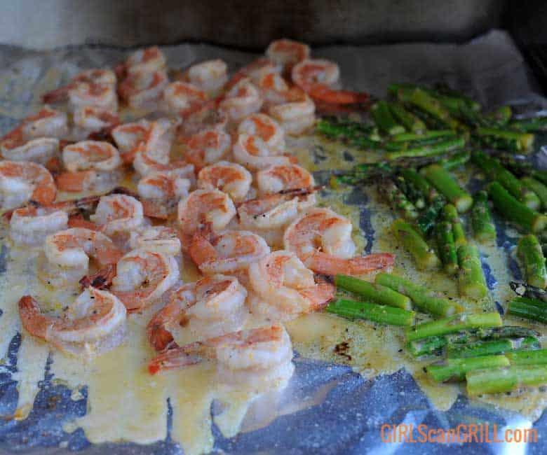 shrimp and asparagus grilling on foil sheets