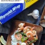 Grilled Lemon Garlic Shrimp and Asparagus with box of Reynolds Wrap® Non-Stick Aluminum Foil