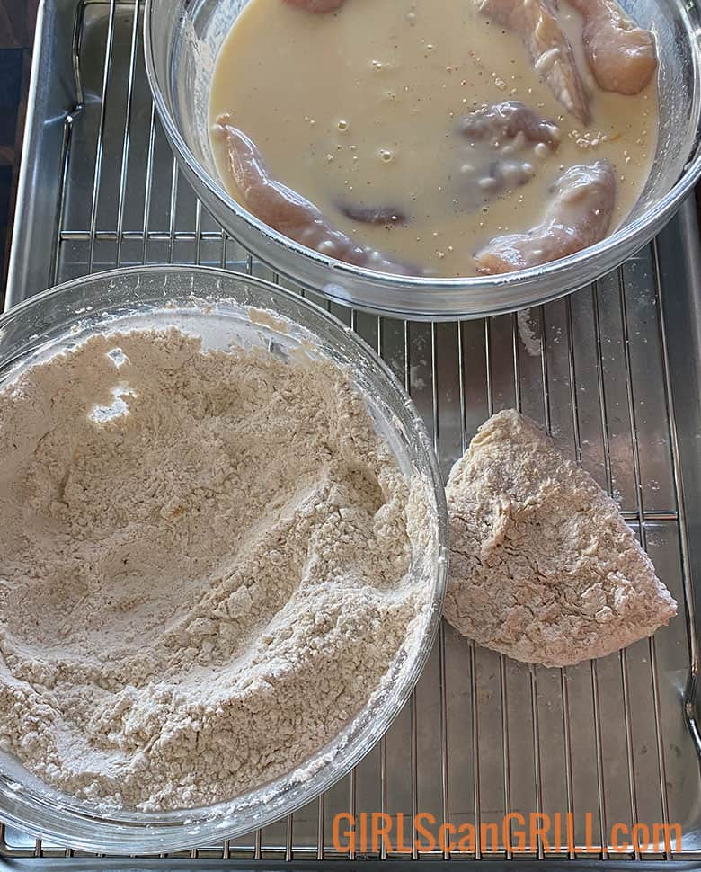 chicken breast dredged in milk and flour