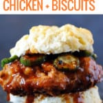 fried chicken on a biscuit with Nashville hot honey sauce and pickles