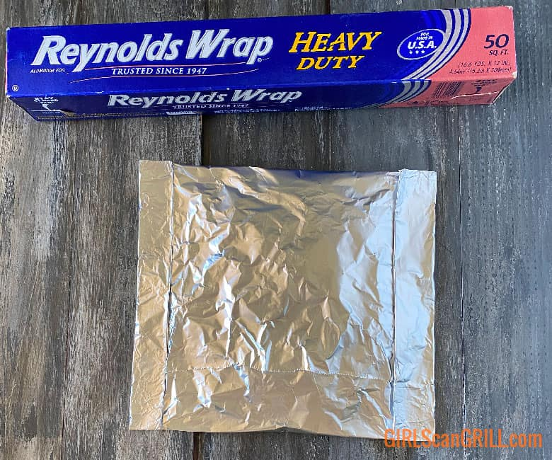 wood chip foil pouch next to box