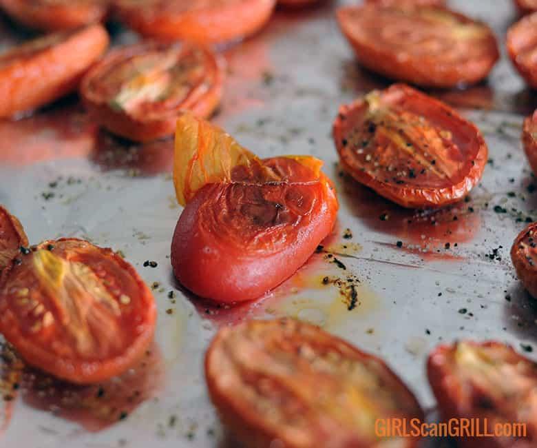 peeling skin off a smoked tomato
