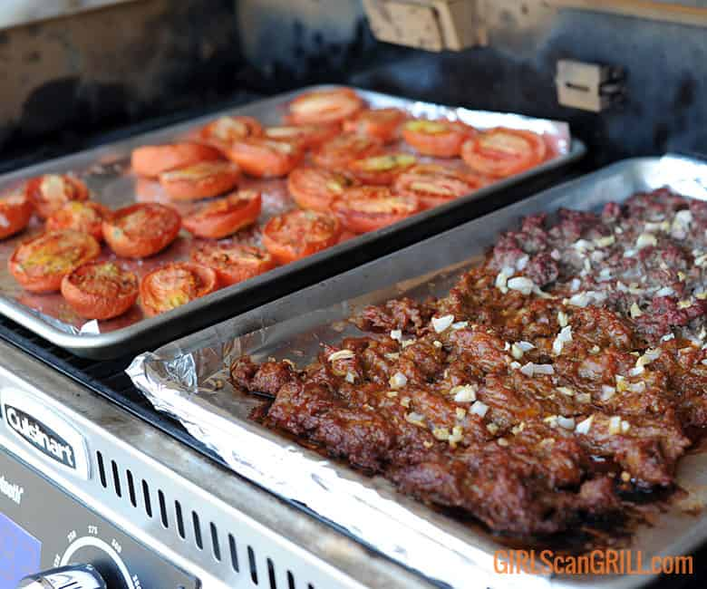 ground pork and sausage on Cuisinart pellet grill with tomatoes
