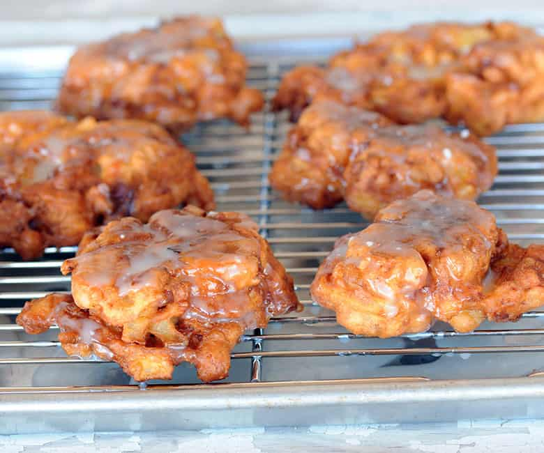 bacon apple fritters resting on cooking rack