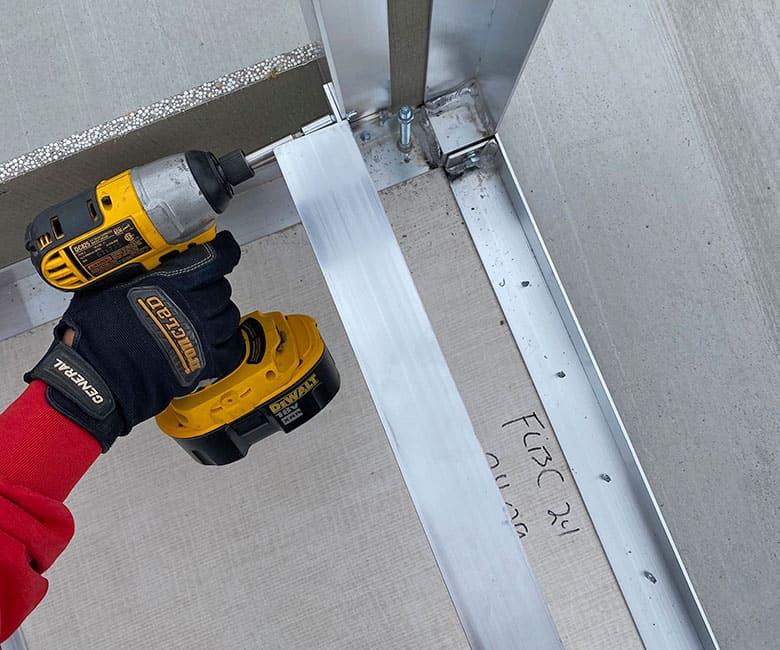 using driver to install horizontal rails