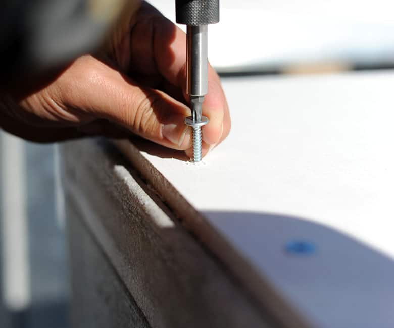 Screwing in a screw to the bottom base