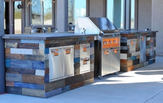 outdoor kitchen with grill and wood siding