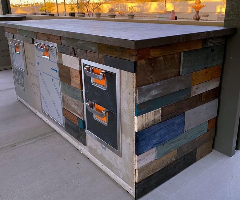 painted wood design on side of BBQ cabinet