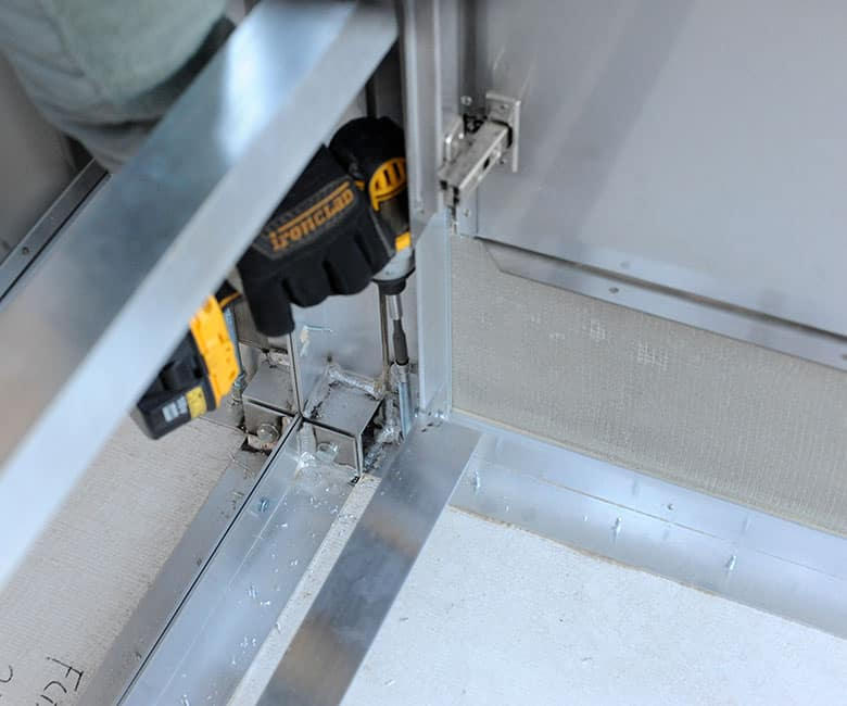 leveling cabinet feet with a drill