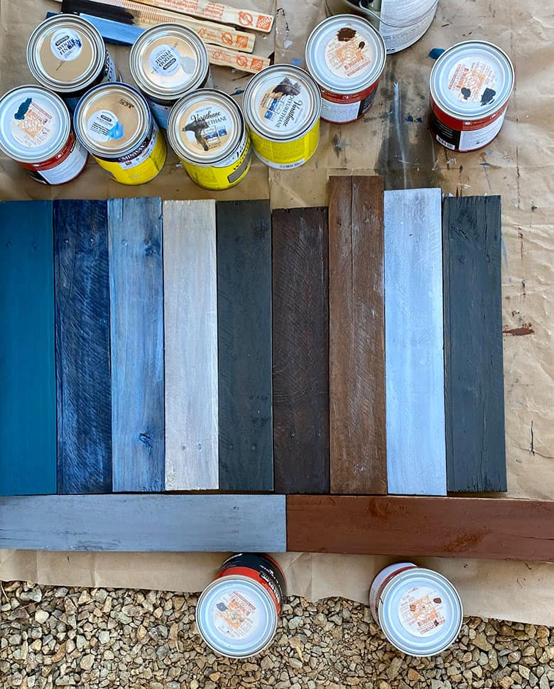 wood pallet pieces painted blue, gray and brown with paint cans