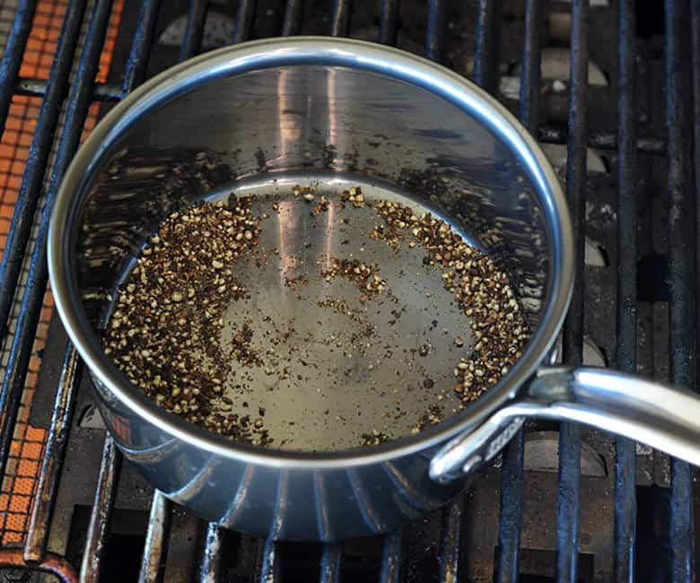 cracked peppercorns toasting in sauce pot
