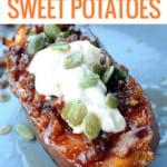 sweet potato half on plate with chorizo, sour cream, pumpkin seeds