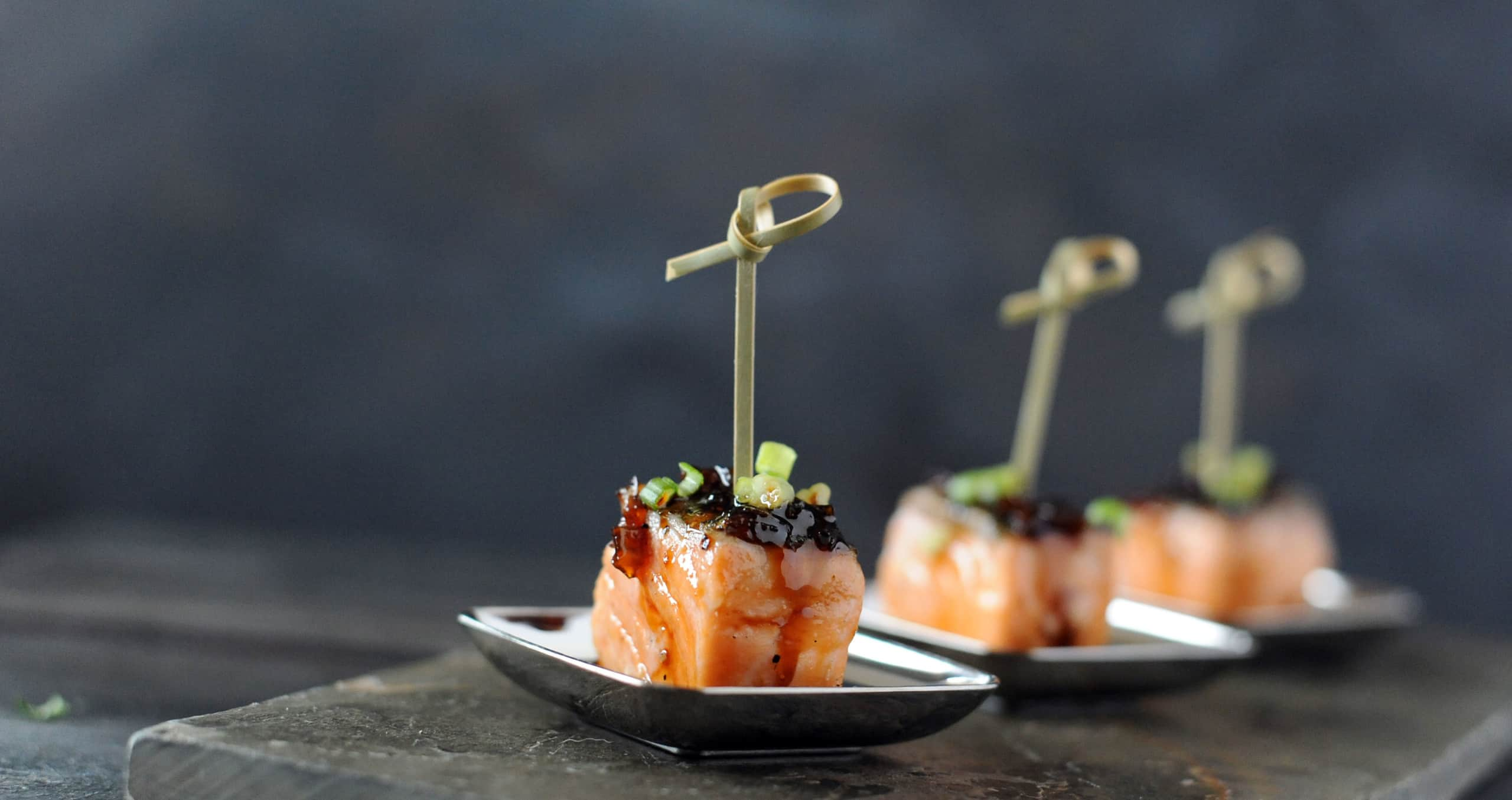 cubed salmon appetizers topped with bourbon glaze