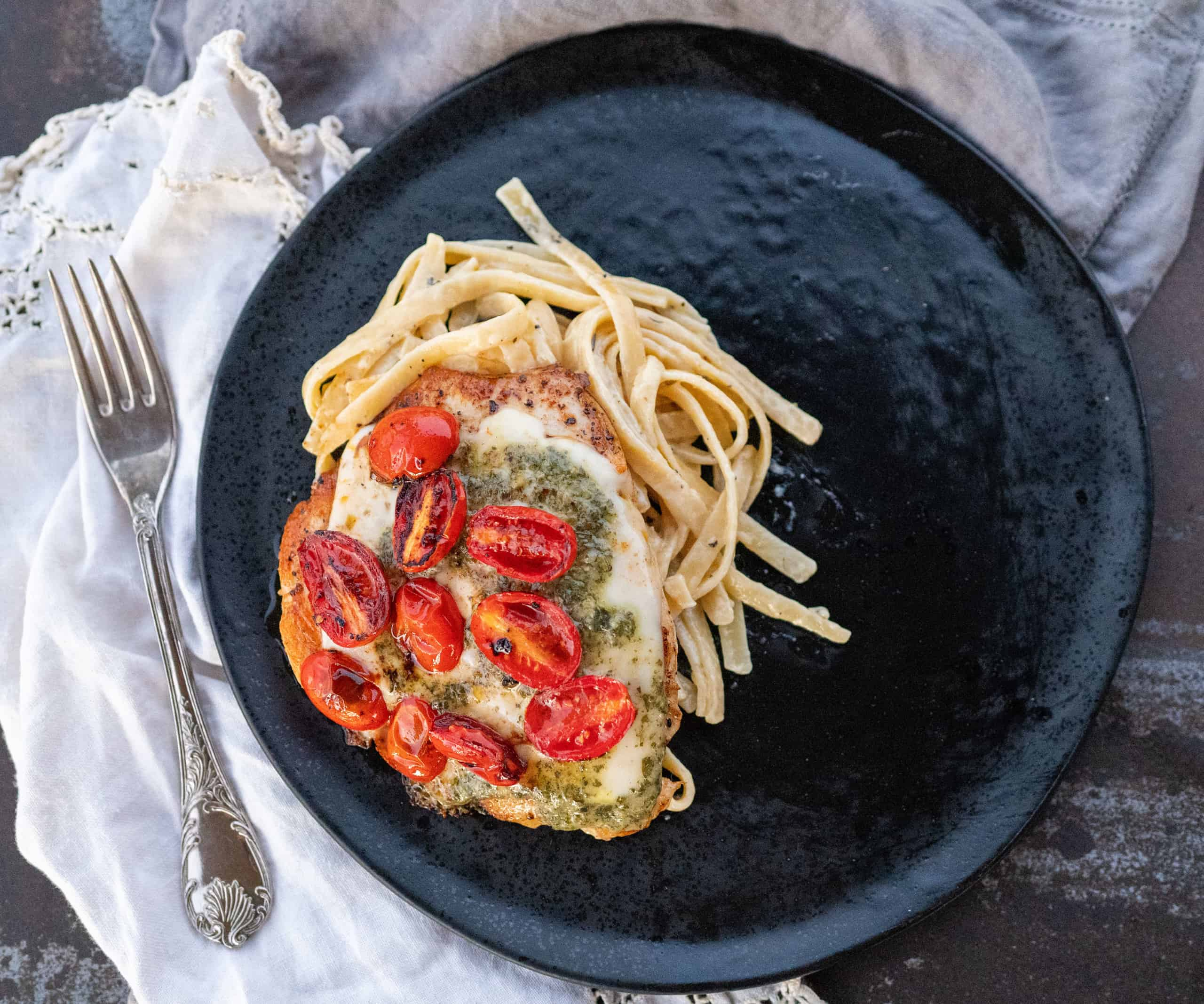 black plate with Grilled Chicken Margherita and pasta