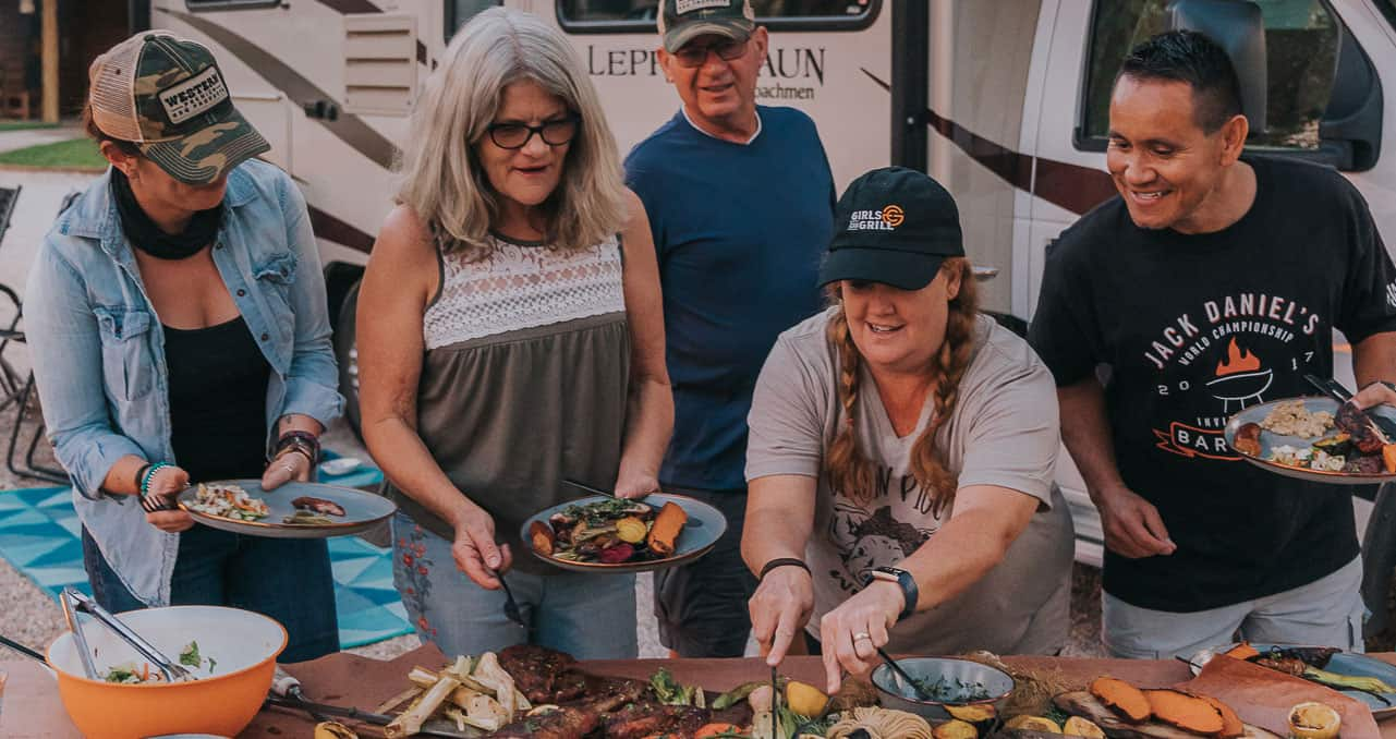 friends and family enjoying grilling recipes