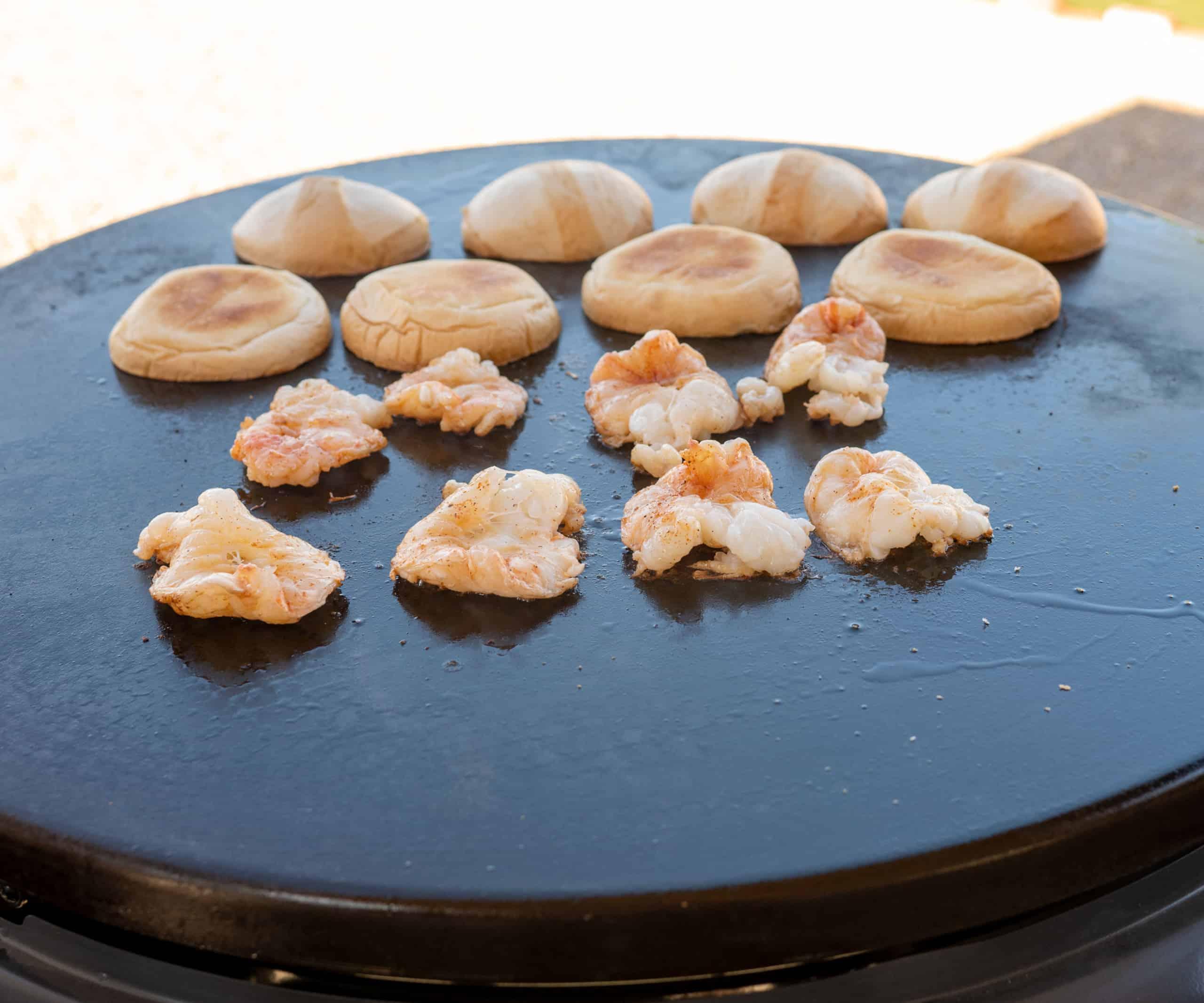 shrimp on griddle vein side down with buns