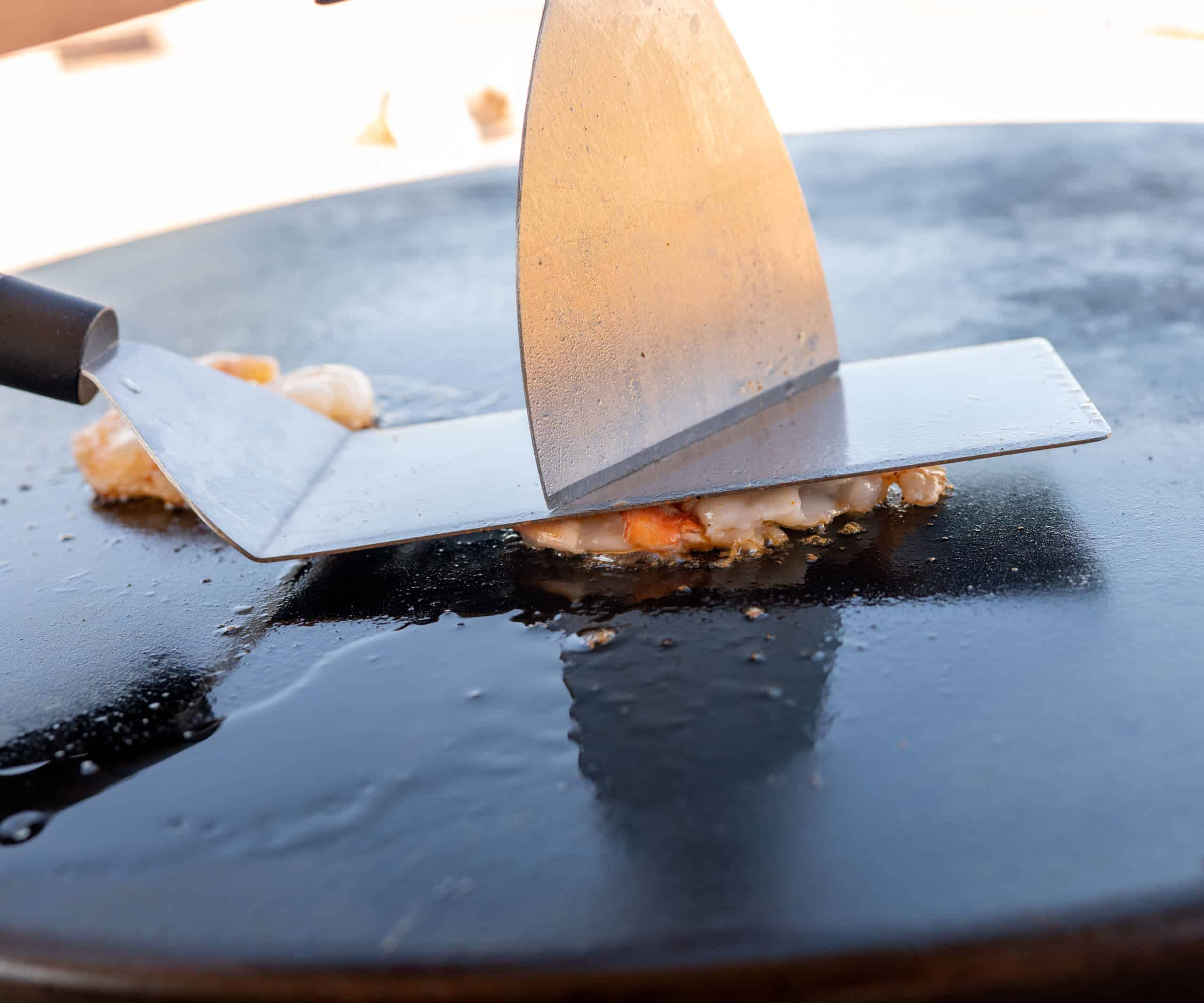 pressing shrimp down with spatula